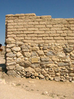 Ancient gate to Tel Be'er Sheva.  The snake-like line in the wall indicates where original structure:  everything below this line) meets restored structure everything above this line.